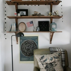 boys-room-shelves-and-chair-with-antler-pillow