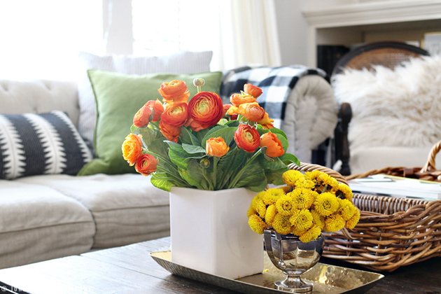 orange ranunculus flower arrangement and yellow mums / jones design company