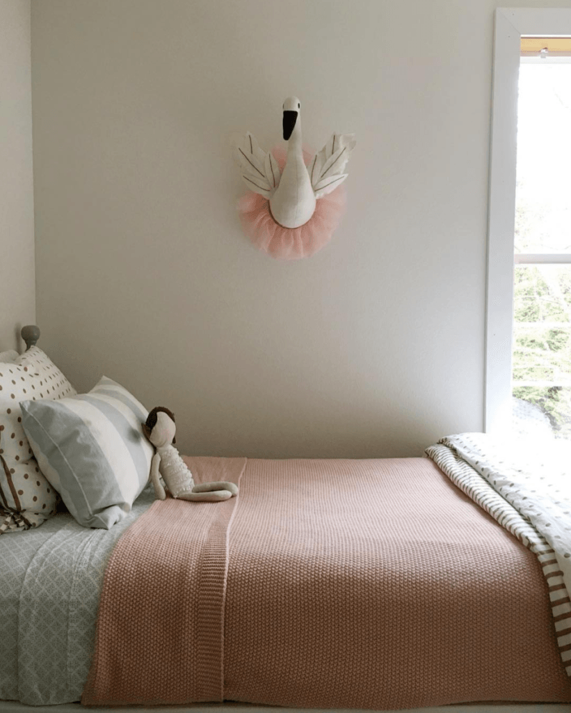Beautiful serene white girls bedroom painted Sherwin Williams Shoji White.  Come see: Best White Paint Colors: 6 Favorites Designers Turn To in case you need paint color ideas. #whitepaintcolors #interiordesign #girlsbedroom